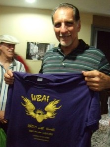 Photo by by Mitchel Cohen, Havana, June, 2013. RADIO WITH HEART. Rene Gonzalez, the only member of the Cuban Five who has been released from U.S. prison, in Havana, Cuba, June 2013. Mr. Gonzalez praised WBAI's fair reporting on the case of the Cuban Five and appreciated the t-shirt (designed by WBAI's Uncle Sidney Smith) that Mitchel Cohen gave him. (Man in background is jazz pianist, Oakland activist and writer William Crossman.)